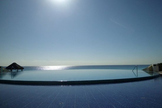 Live Aqua Cancun All Inclusive:                   View from our pool side chairs looking across one of the infinity pools to the