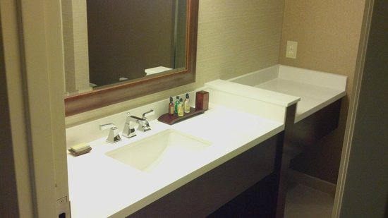 Minneapolis Marriott Northwest:                   Extra Long Counter....notice the extra space away from the sink!