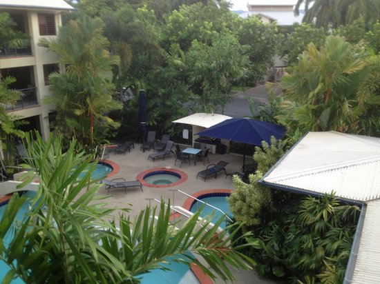 Meridian Port Douglas:                   Umbrellas by pool for shade