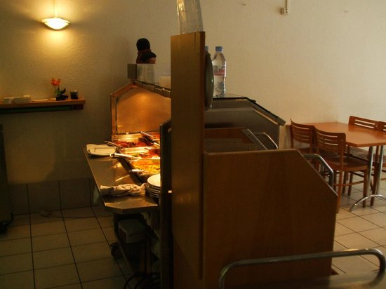 Aroy-Di:                   Behind the food presentation line
