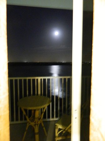 Blue Heron Beach Resort:                   Moonlight out patio door over balcony.