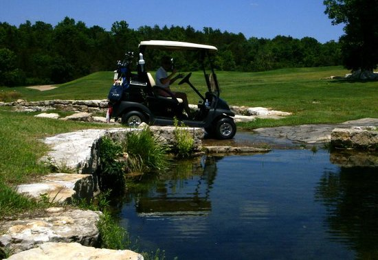 John Daly's Murder Rock Golf Club: water flowing over the golf cart path