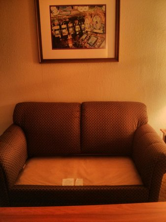 Mardi Gras Hotel & Casino:                   Sofa pillows gone to close the door gap.