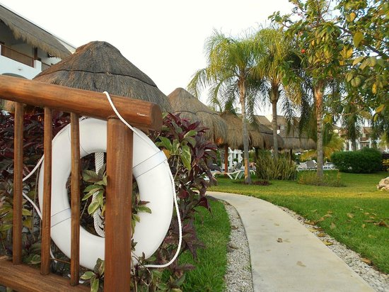 Valentin Imperial Riviera Maya:                   about to cross the little bridge by our building pool area
