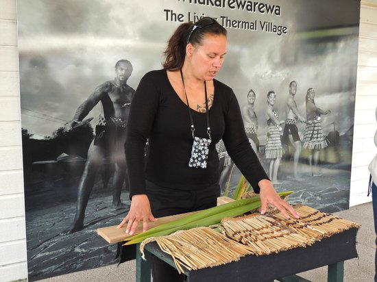 Whakarewarewa - The Living Maori Village: craft demonstration, included the note that this is a modern use of the versatile flax plant