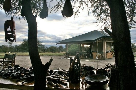 Whistling Thorn Tented Camp:                   The Dining tent and lounge from the table of Maasai handicraft