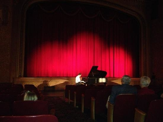 Paramount Theatre:                   Piano Man Mike Schuler entertains the audience before a viewing of The Neveren