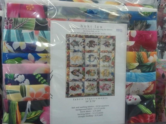 Kapaia Stitchery:                   They have many kits that include fabric so you can sew when you get home.