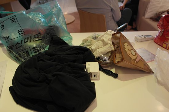 PARKROYAL Serviced Suites Kuala Lumpur:                   Stuff being put in the green plastic bag.