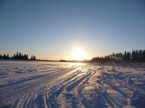 Lapland Guesthouse:                   The frozen river beside the guesthouse
