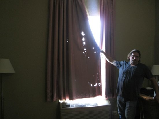 Rodeway Inn of Wesley Chapel :                   Maybe the problem was we checked out on a Sunday, so the curtains were holy.