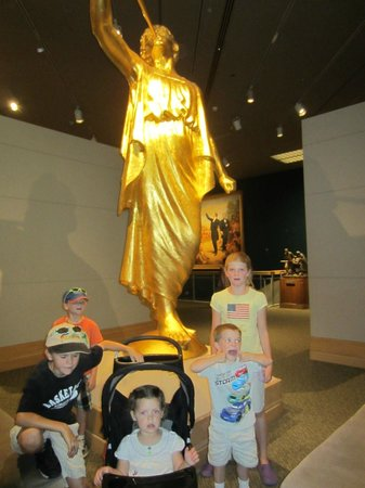 Church History Museum :                   By the angel Moroni which tops LDS temples