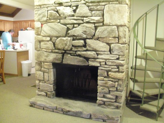Wyndham Resort at Fairfield Mountains:                   fireplace & stairs going up to loft. Good size room up there.