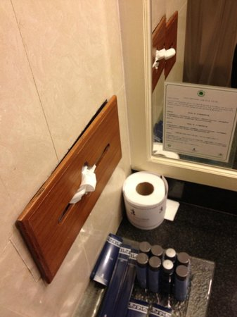 Royal Cliff Beach Hotel:                   tissue box holder was simply taped onto the wall to prevent it from falling do