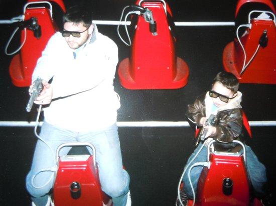 Shoot'em Up Cinema:                   My Husband and Son enjoying themselves :)