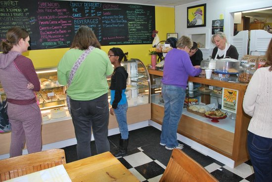 Mockingbird Cafe & Bakery:                   Lunch crowd looking at all the wonderful food choices