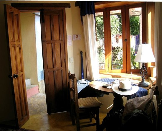 Bela's B&B:                                     Entrance, table & window