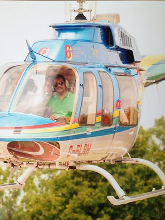 King Tours:                   My dad in the helicopter!! So cute!