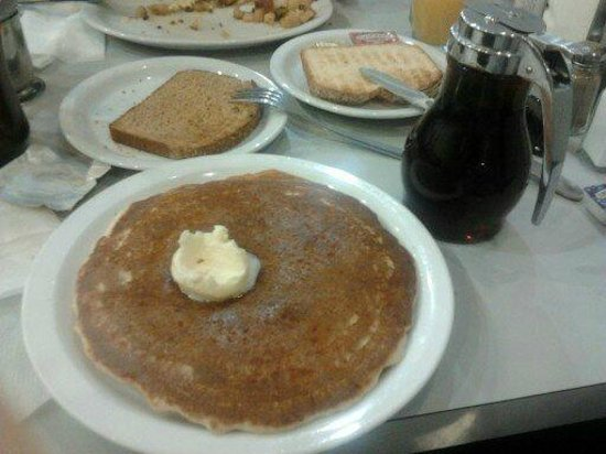 Olympic Flame Cafe:                   Pancakes, two slices