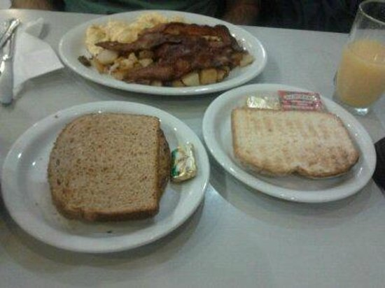 Olympic Flame Cafe:                   Scrumble eggs and bacon with bread