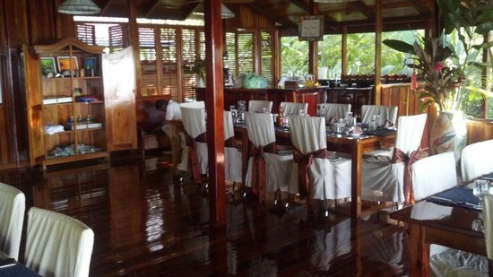 "La Paloma Lodge:                   Dining room dressed for dinner.  Armoire is the ""gift shop"".  Laundry bags on"
