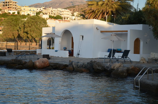 Minos Beach Art hotel:                   Bungalow 102 with its own sun loungers, and views towards Ag Nik harbour