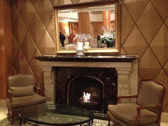 Millennium Gloucester Hotel London Kensington:                   the welcoming fire in the hotel lobby