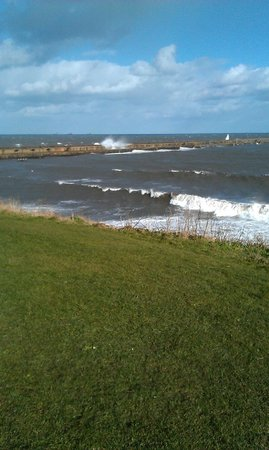 Oceans Fish and Chip Restaurant: View of waves crashing over the pier at North Shields