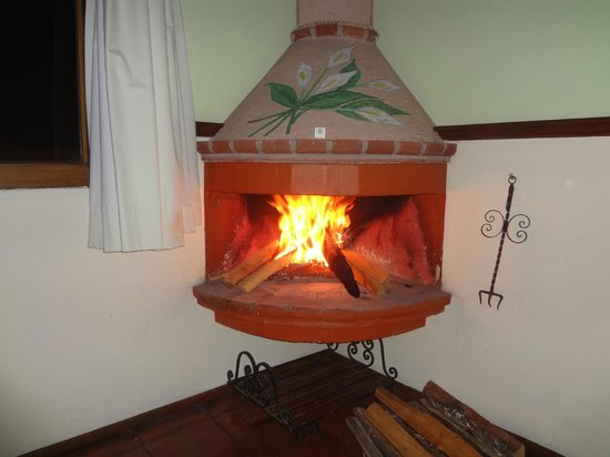 Villa San Jose Hotel & Suites:                   fireplace in suite