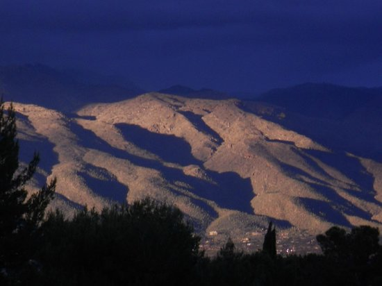 Radisson Suites Tucson:                   Shadows on the Catalina's during a storm