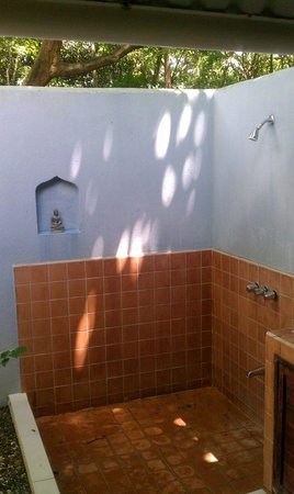 Milarepa:                   Open air shower (toilet is under roofing)