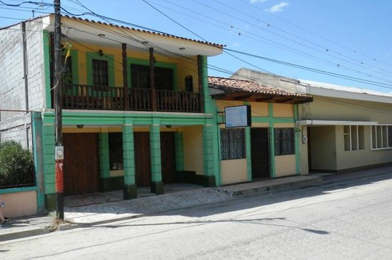 Llamarada del Bosque:                   View from Street - Second floor front porch access from rooms