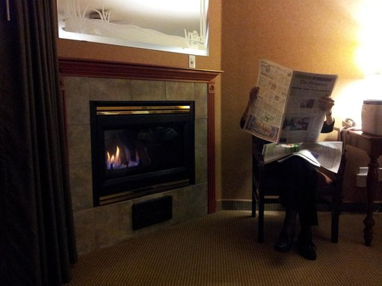 Elizabeth Street Inn: reading a complimentary paper by the fire