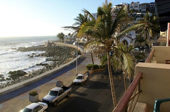 Hotel la Siesta:                   View from our balcony of the malecon, street and beach.