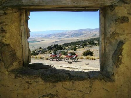 Central Otago Motorcycle Tours :                   Looking down on the bikes at Bendigo Station