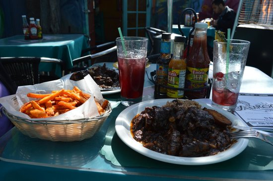 Jamroc 101 Caribbean Grill :                   Oxtail with rice and peas, sweet potato fries and sangria