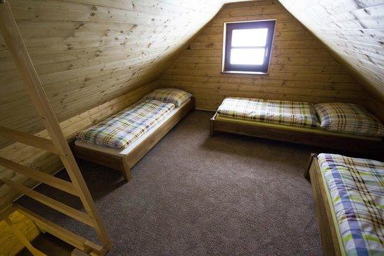 Penzion Rzehaczek: Podkrovni loznice u 5 luzkoveho apartmanu, sypialnia na poddaszu u 5cio osobowego apartamentu