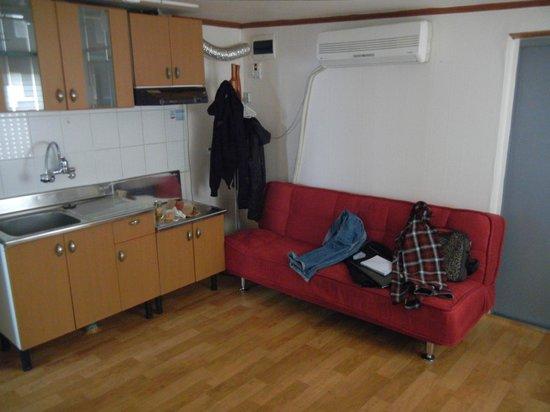 B&J Guest House :                                     kitchen corner and sofa