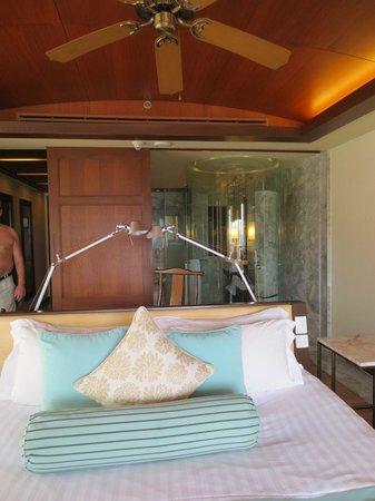 Centara Grand Beach Resort Phuket: Bedroom, walk-in shower with sliding wooden doors.