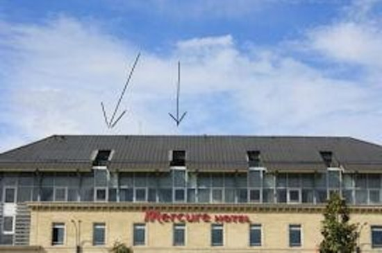 Mercure Perigueux Centre Hotel :                                     Gun Turret Windows beneath a mansard roof.