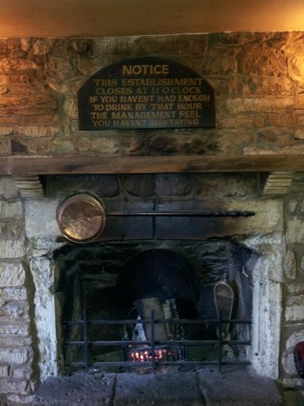 Rose & Crown Inn:                   Wisdom above the bar fireplace
