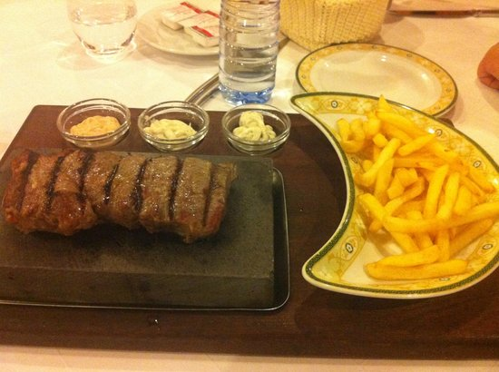 Restaurante O Pescador:                   steak on a rock with 3 dips and fries