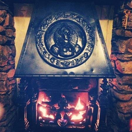 Royal Oak Inn :                   the fire in one of the dinning areas, just what you need after a day of walkin