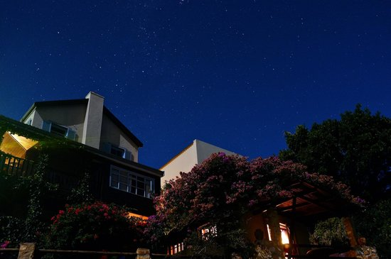 TwoAngels Guest House:                   View of Lover's Nest cottage from the lagoon at night