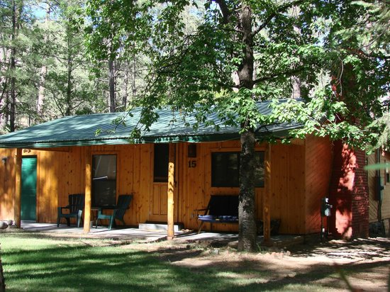 "Story Book Cabins: Cabin #15 ""Pine Tree"" An upscale rustic cabin with a relaxing front porch and optional outdoor h"