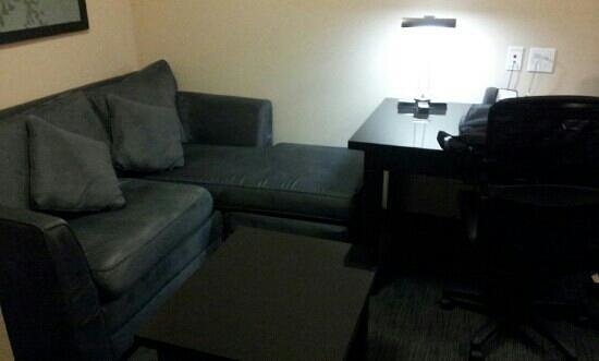 BEST WESTERN PLUS Avita Suites:                   sitting area and desk