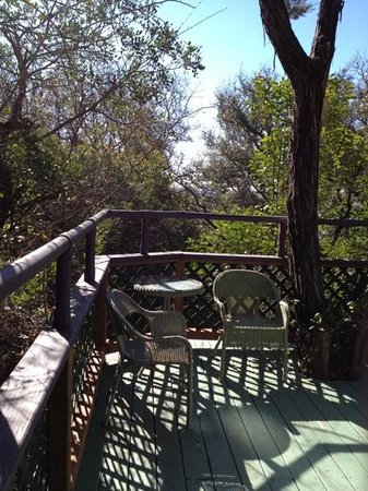 Rainbow Hearth Sanctuary and Retreat: Sitting area on the deck of the yurt.