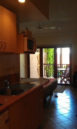 Hibiscus Resort & Spa:                   Looking from bathroom into kitchenette/sleeping area at balcony beyond