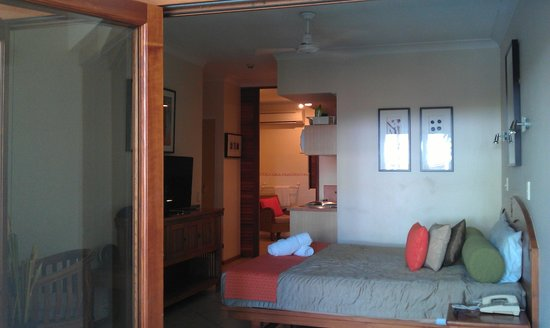 Hibiscus Gardens Spa Resort:                   Studio room from balcony - trifold doors opened