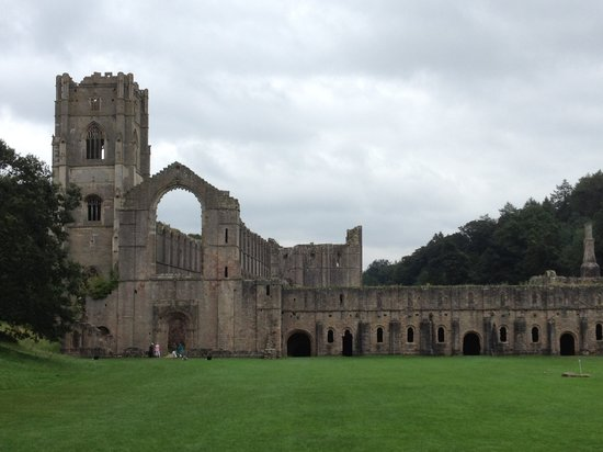 Fountains Abbey and Studley Royal Water Garden:                   Fountains Abbey as you walk toward it